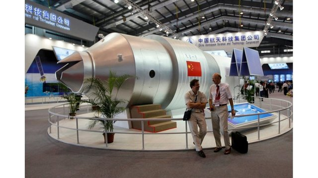 Out of control Chinese space lab mostly burns up on re-entry in south Pacific